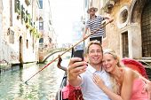 stock photo of boat  - Couple in Venice on Gondole ride romance in boat happy together on travel vacation holidays - JPG