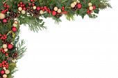 Christmas floral background border with red and gold bauble decorations, holly, mistletoe, ivy and winter greenery.