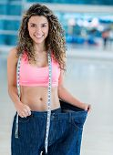 Fit woman in baggy pants after loosing weight