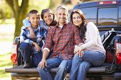stock photo of 11 year old  - Family Sitting In Pick Up Truck On Camping Holiday - JPG