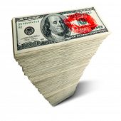 Stack of one hundred dollar bills with red kiss on white background