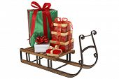 Christmas presents on wooden sleigh on white background