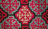 stock photo of yurt  - Kazak felt carpet with ornament on the wall of the yurt - JPG