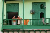 Cuban Women Standing On Balcony