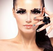 Face Of Beautiful Fashion Woman With  Black False Eyelashes