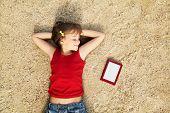 girl lying on the sand