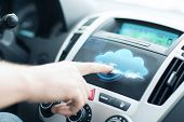 transportation, future technology and vehicle concept - man using car control panel