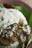 stock photo of biryani  - Fish Biryani, biriani, or beriani is a set of primarily Indian or South Asian rice-based dish made with spices, rice (usually basmati) and meat/vegetables.