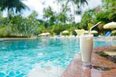 cool refreshing coctail near swimming pool on vacation