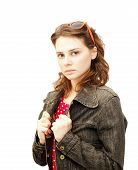 Beautiful Young Woman In A Denim Jacket With Sun Glasses Isolated On White Background