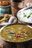 stock photo of ghee  - Palak tuvar dal made of tuvvar dal cooked with spinach - JPG