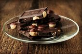 Black Chocolate With Nuts In A Glass Saucer