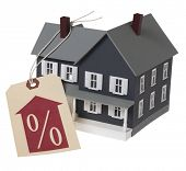 toy doll house with percentage tag and arrow on white background