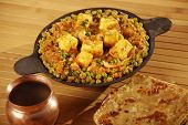 stock photo of paneer  - Top view of Matter paneer. This is a north Indian dish consisting of Paneer,the Indian cottage cheese and peas in a slightly sweet and spicy sauce and served with roti.