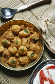 Kashmiri dum aloo is a deep fried baby potatoes cooked in yogurt