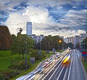 Highway In Warsaw With Vehicles In Motion And Stormy Sky.