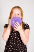 Girl Is Blowing Up A Balloon
