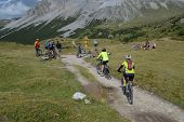 Mountain Bikers Riding Though Swiss Mountain Area