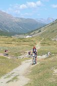 Mountain Bikers Riding Though Swiss Mountain Area