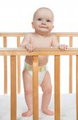Infant Child Baby Boy Toddler Standing In Diaper In Wooden Bed