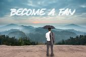 The word become a fan and businessman standing back to camera holding umbrella and jacket on shoulder against scenic countryside with mountains
