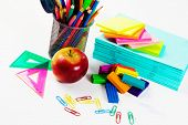 Colored pencils plasticine papers and other school items