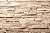 Decorative slate beige stone wall pattern, background.