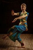 foto of bharatanatyam  - Vintage retro style image of young beautiful woman dancer exponent of Indian classical dance Bharatanatyam in Shiva pose - JPG