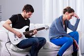 Rockman Playing Guitar And Bored Woman
