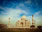 Vintage retro hipster style travel image of  Taj Mahal. Indian Symbol - India travel background with grunge texture overlaid. Agra, India