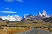 Famous rock Fitz Roy peaks in the Andes. Excellent highway in El Chalten.  Magnificent panorama of s