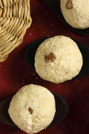 foto of laddu  - Rava Laddu or Laddoo is an Indian and Bengali sweet that is often prepared to celebrate festivals or household events such as weddings - JPG