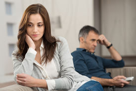 pic of conflict couple  - Sad Couple Sitting On Couch After Having Quarrel - JPG