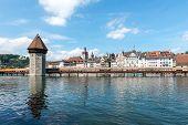 Water Tower And Chapel Bridge (kapellbruecke) In Lucerne (switzerland)