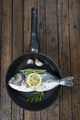 Fresh Bream Fish With Herbs And Spices On A Pan