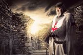 picture of crusader  - Knight Templar posing near some ruins at sunset - JPG