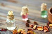 Aromatic essences in small bottles and dry leaves near by
