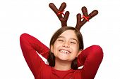 Festive little girl wearing antlers on white background