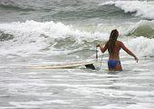Girl Going Surfing