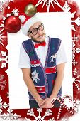 Geeky hipster in santa hat against christmas themed page