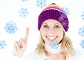 Positive woman showing up smiling at the camera against white background against snowflakes