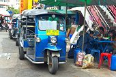 Famous Three-wheeled Taxi (tuktuk) Parking At The Street