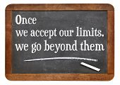 Постер, плакат: once we accept our limits we go beyond them a quote from Albert Einstein on a vintage slate black