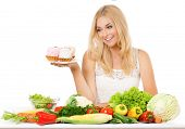 Woman with vegetables and cake