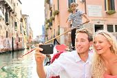 Постер, плакат: Travel couple in Venice on Gondole ride romance in boat happy on vacation holidays Romantic young b