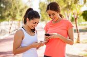 Two Female Runners Texting