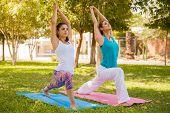 Focused Girls Doing Yoga