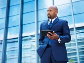 mature african american businessman using tablet