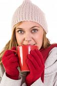 Happy blonde in winter clothes holding mug on white background