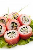 Tuna Maki Sushi - Roll made of Smoked Eel and Cucumber inside. Fresh Raw Tuna outside